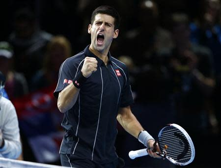 Djokovic of Serbia celebrates winning his men's singles tennis match against Gasquet of France at the ATP World Tour Finals in London