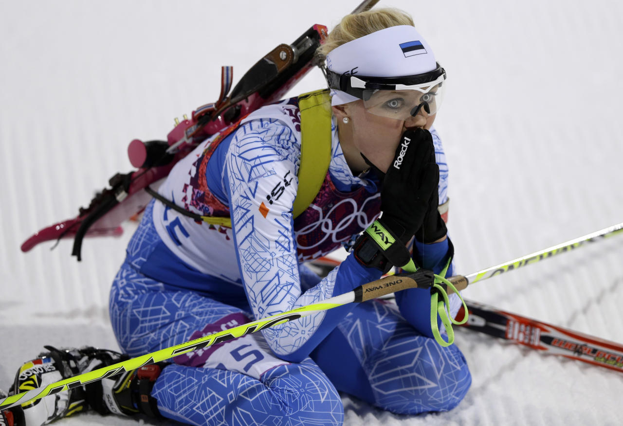 Estonia's Grete Gaim looks up after completing the women's biathlon 7.5k sprint, at the 2014 Winter Olympics, Sunday, Feb. 9, 2014, in Krasnaya Polyana, Russia. (AP Photo/Kirsty Wigglesworth)