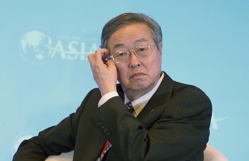 Zhou scratches his head during a session of the BFA Annual Conference 2014, in Qionghai