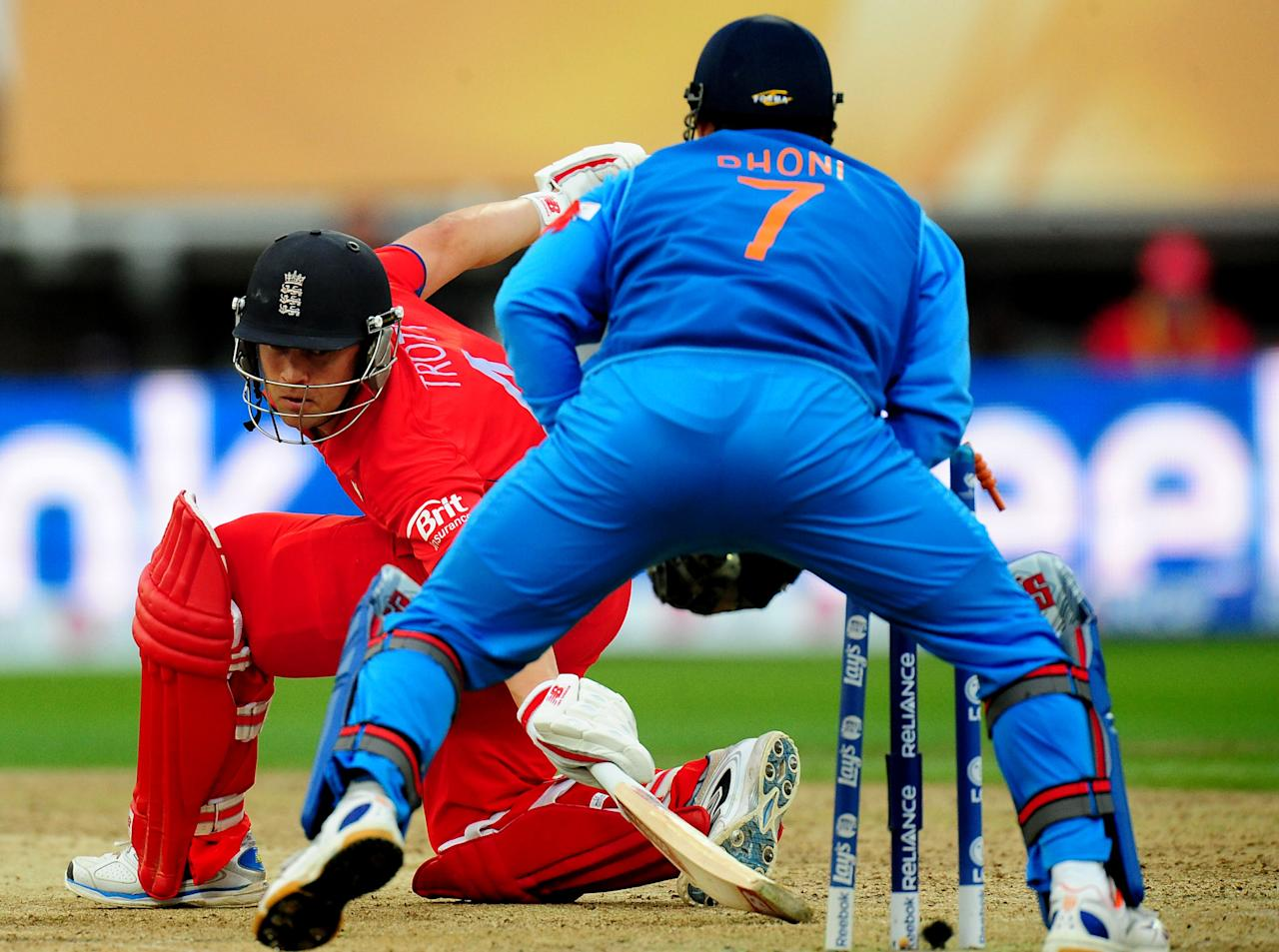 England's Jonathan Trott is stumped by Mahendra Dhoni for 20 during the ICC Champions Trophy Final at Edgbaston, Birmingham.