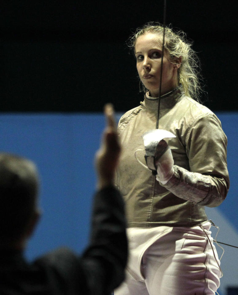 Mariel Zagunis, of the United States, salutes raising his sabre as she is declared the winner of the women's individual sabre final against Venezuela's Alejandra Benitez in the fencing competition at the Pan American Games in Guadalajara, Mexico, Tuesday, Oct. 25, 2011. Zagunis got the gold medal. (AP Photo/Jorge Saenz)