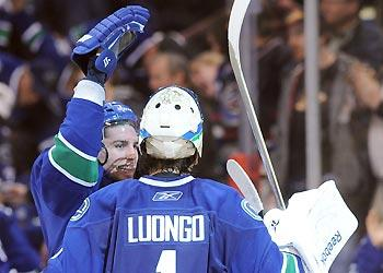 Roberto Luongo made a mistake to allow San Jose's first goal, but his teammates bailed him out by rallying to score twice in the third period