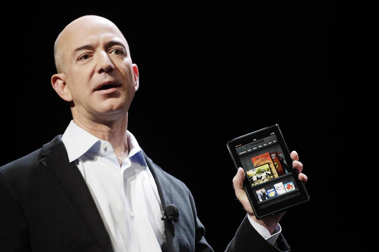 FILE - In this Sept. 28, 2011 file photo, Jeff Bezos, Chairman and CEO of Amazon.com, introduces the Kindle Fire at a news conference, in New York. Amazon,com releases quarterly financial results Tuesday, Oct. 25, 2011, after the market close. (AP Photo/Mark Lennihan, File)