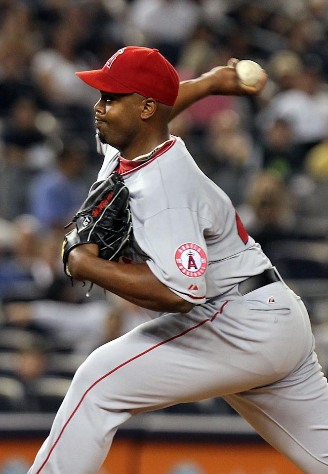 NEW YORK, NY - APRIL 15:  Jerome Williams of the Los Angeles Angels of Anaheim pitches against the New York Yankees  at Yankee Stadium on April 15, 2012 in the Bronx borough of New York City. In honor of Jackie Robinson Day, all players across Major League Baseball will wear number 42(Photo by Nick Laham/Getty Images)