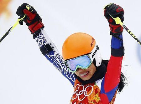 Vanessa Mae reacts in the finish area after competing in the first run of the women's alpine skiing giant slalom event during the 2014 Sochi Winter Olympics at the Rosa Khutor Alpine Center