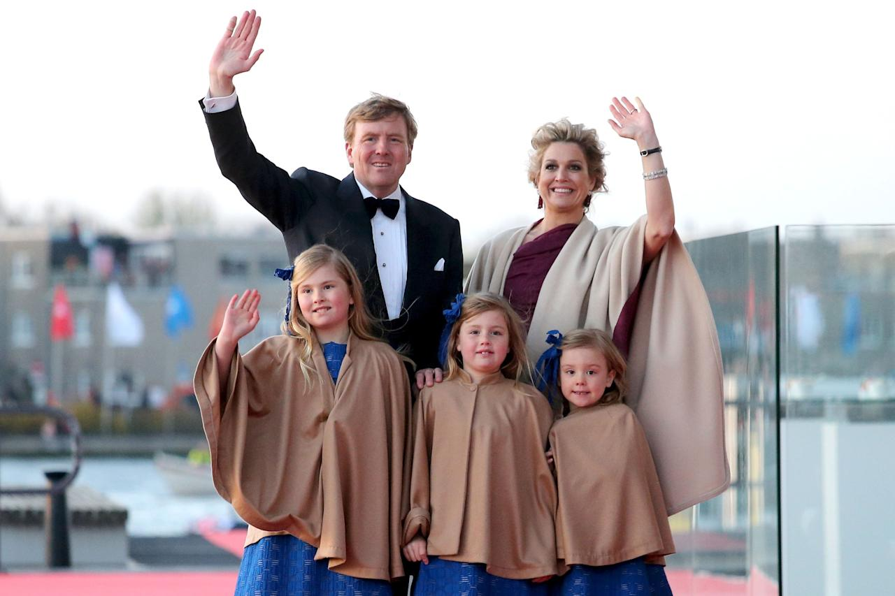 AMSTERDAM, NETHERLANDS - APRIL 30:  King Willem Alexander; Queen Maxima and their daughters Princess Catharina-Amalia; Princess Alexia and Princess Ariane of The Netherlands arrive at the Muziekbouw following the water pageant after the abdication of Queen Beatrix of the Netherlands and the Inauguration of King Willem Alexander of the Netherlands on April 30, 2013 in Amsterdam, Netherlands.  (Photo by Chris Jackson/Getty Images)