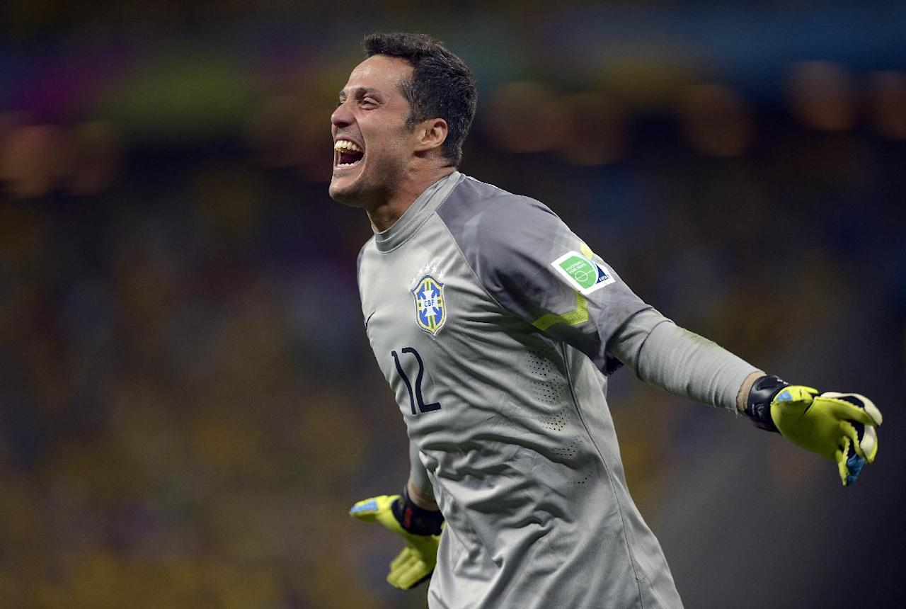 Brazil's goalkeeper Julio Cesar celebrates after David Luiz scored his side's second goal during the World Cup quarterfinal soccer match between Brazil and Colombia at the Arena Castelao in Fortaleza, Brazil, Friday, July 4, 2014.  (AP Photo/Manu Fernandez)