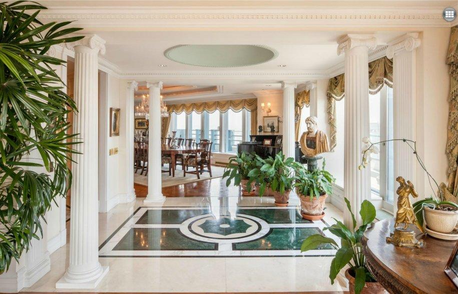 The entryway is reminiscent of Versailles.