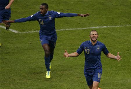 France's Benzema celebrates after scoring the second goal for the team during their 2014 World Cup qualifying second leg playoff soccer match against Ukraine at the Stade de France in Saint-Denis near Paris