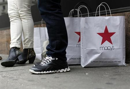 Customers stand outside Macy's store in New York