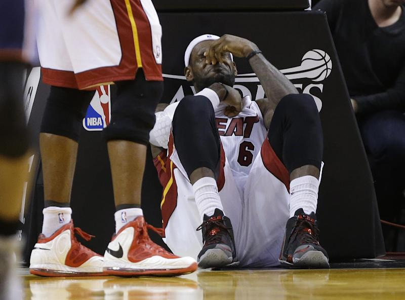 LeBron taking a beating, and Heat not happy