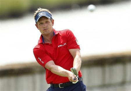 England's Luke Donald chips on to the 18th green during the second round of the Barclays PGA golf tournament in Jersey City