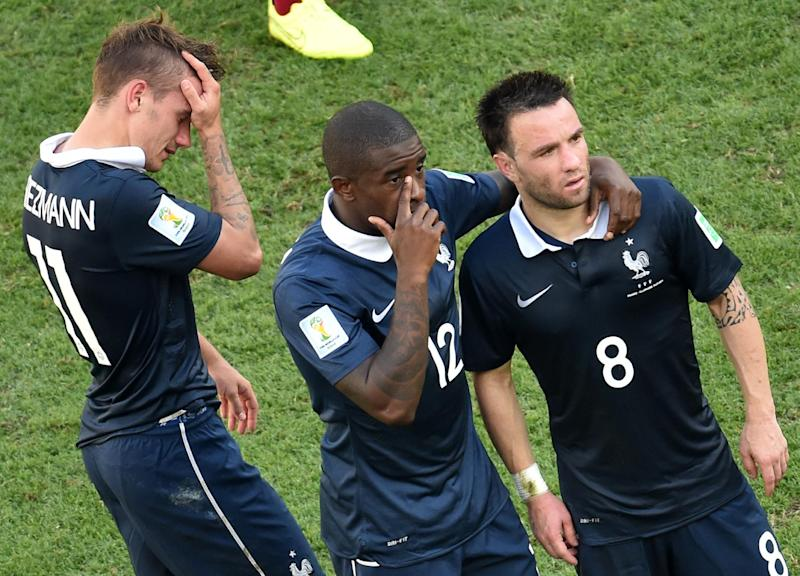(L/R): France's Antoine Griezmann, Rio Mavuba and Mathieu Valbuena react after their 1-0 defeat to Germany in the quarter-final at The Maracana Stadium in Rio de Janeiro on July 4, 2014, during the 2014 FIFA World Cup