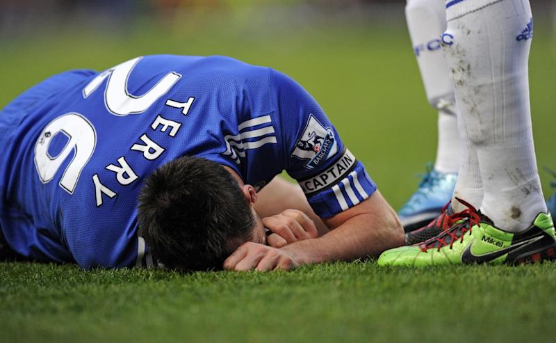 Chelsea's English defender John Terry lies injured after taking a knock to the head during the English Premier League football match on December 28, 2009