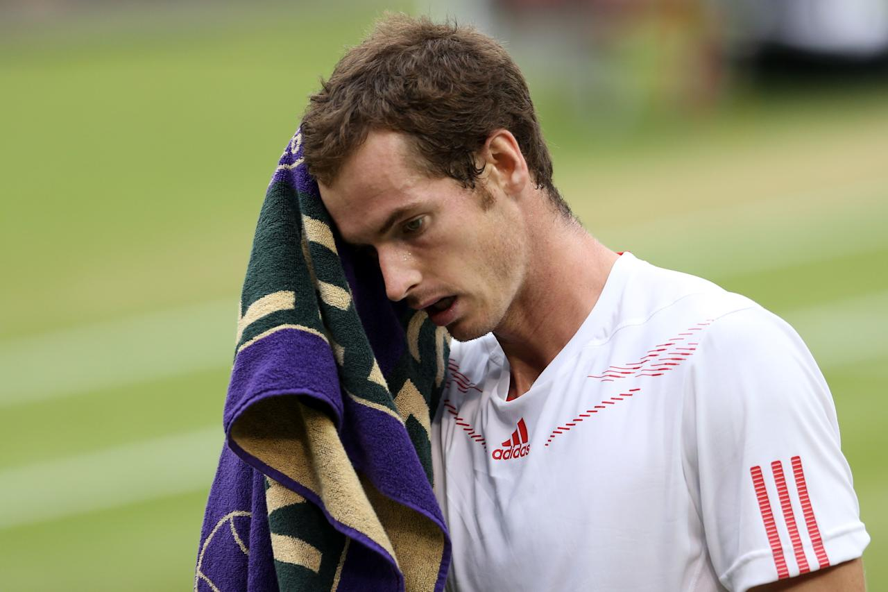 LONDON, ENGLAND - JULY 08:  Andy Murray of Great Britain shows his dejection during his Gentlemen's Singles final match against Roger Federer of Switzerland on day thirteen of the Wimbledon Lawn Tennis Championships at the All England Lawn Tennis and Croquet Club on July 8, 2012 in London, England.  (Photo by Julian Finney/Getty Images)