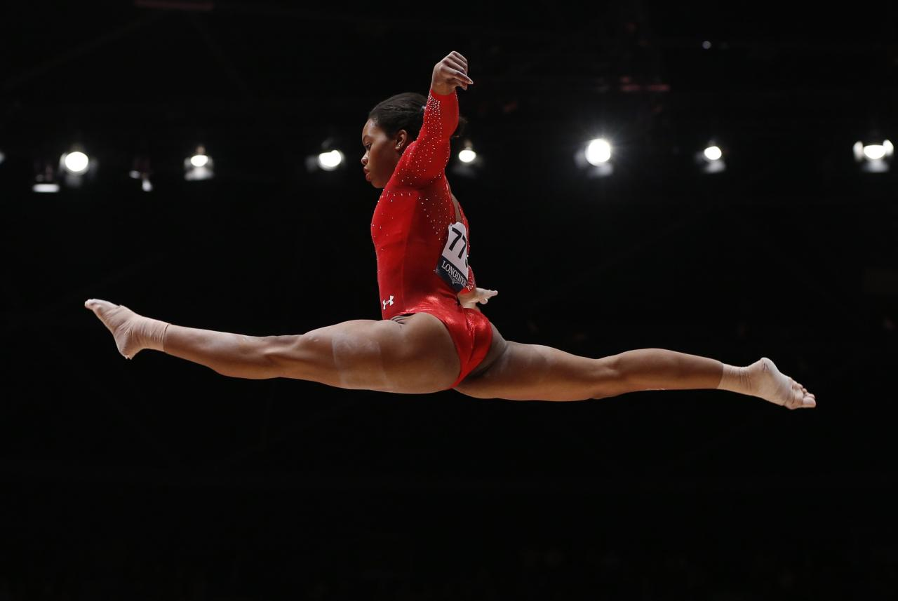 FILE PHOTO - Gabrielle Douglas of the U.S competes on the beam during the women's all-round final at the World Gymnastics Championships at the Hydro Arena in Glasgow, Scotland, October 29, 2015.   REUTERS/Phil Noble/File photo