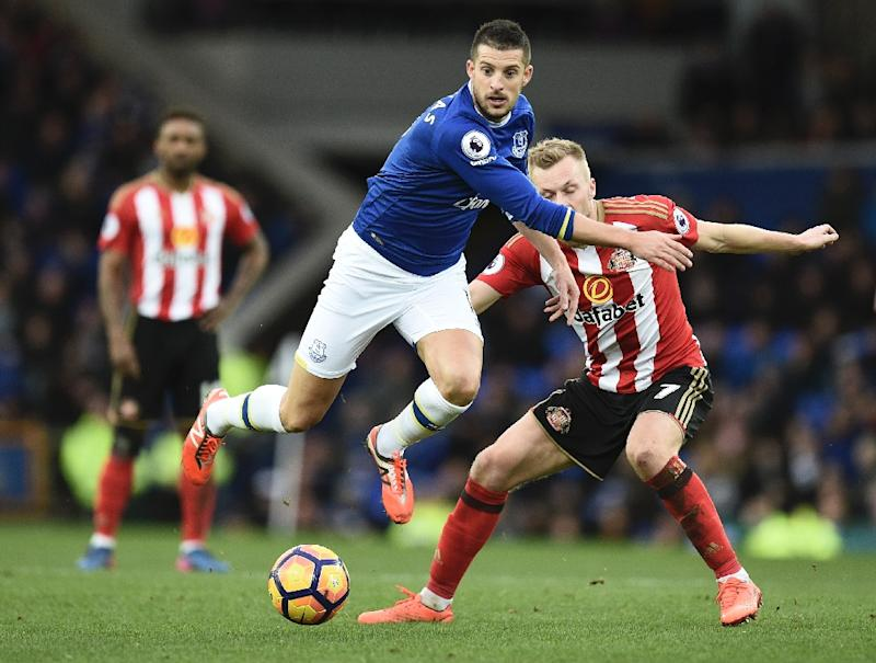 Everton's striker Kevin Mirallas vies with Sunderland's midfielder Sebastian Larsson during the English Premier League football match