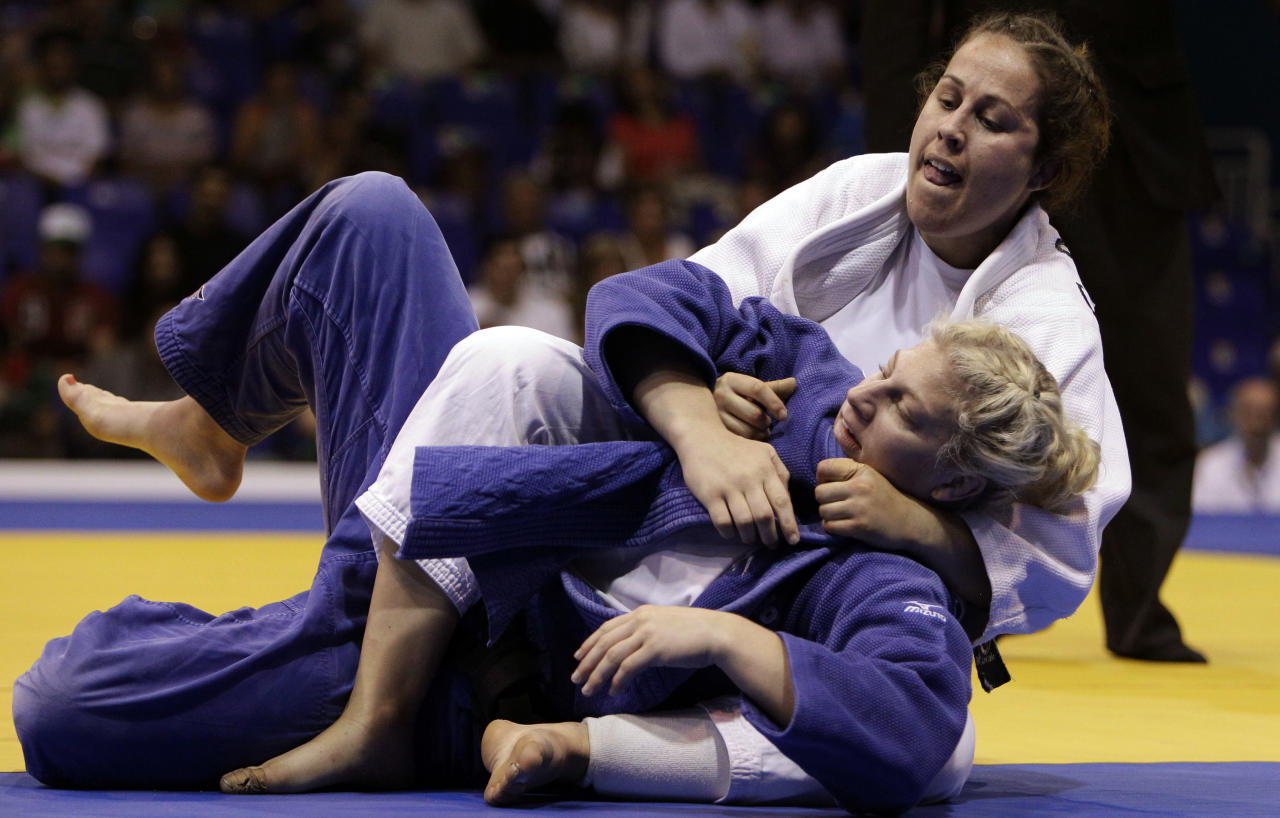 Canada's Catherine Roberge, top, and and United States' Kayla Harrison fight during a women's -78 kg judo match at the Pan American Games in Guadalajara, Mexico, Thursday Oct. 27, 2011. (AP Photo/Javier Galeano)