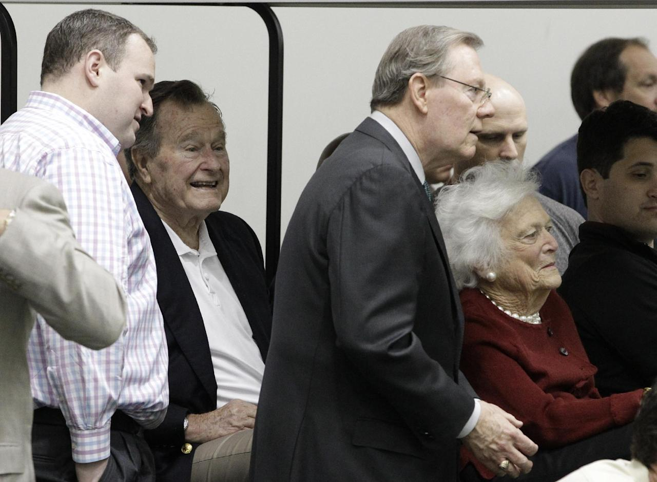 Former President George H.W. Bush and Barbara Bush attend Texas A&M quarterback Johnny Manziel's pro day for NFL football representatives in College Station, Texas, Thursday, March 27, 2014. (AP Photo/Patric Schneider)