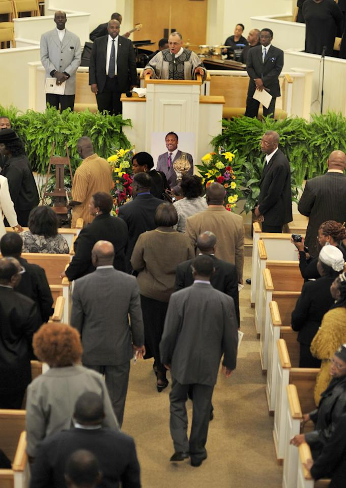 Joe Frazier's family and friends gather during a memorial service for the former heavyweight champion at the Bethesda Christian Fellowship Temple, Wednesday, Nov. 16, 2011 in St. Helena Island, S.C. Frazier died earlier this month from liver cancer. He was 67. (AP Photo/Stephen Morton)