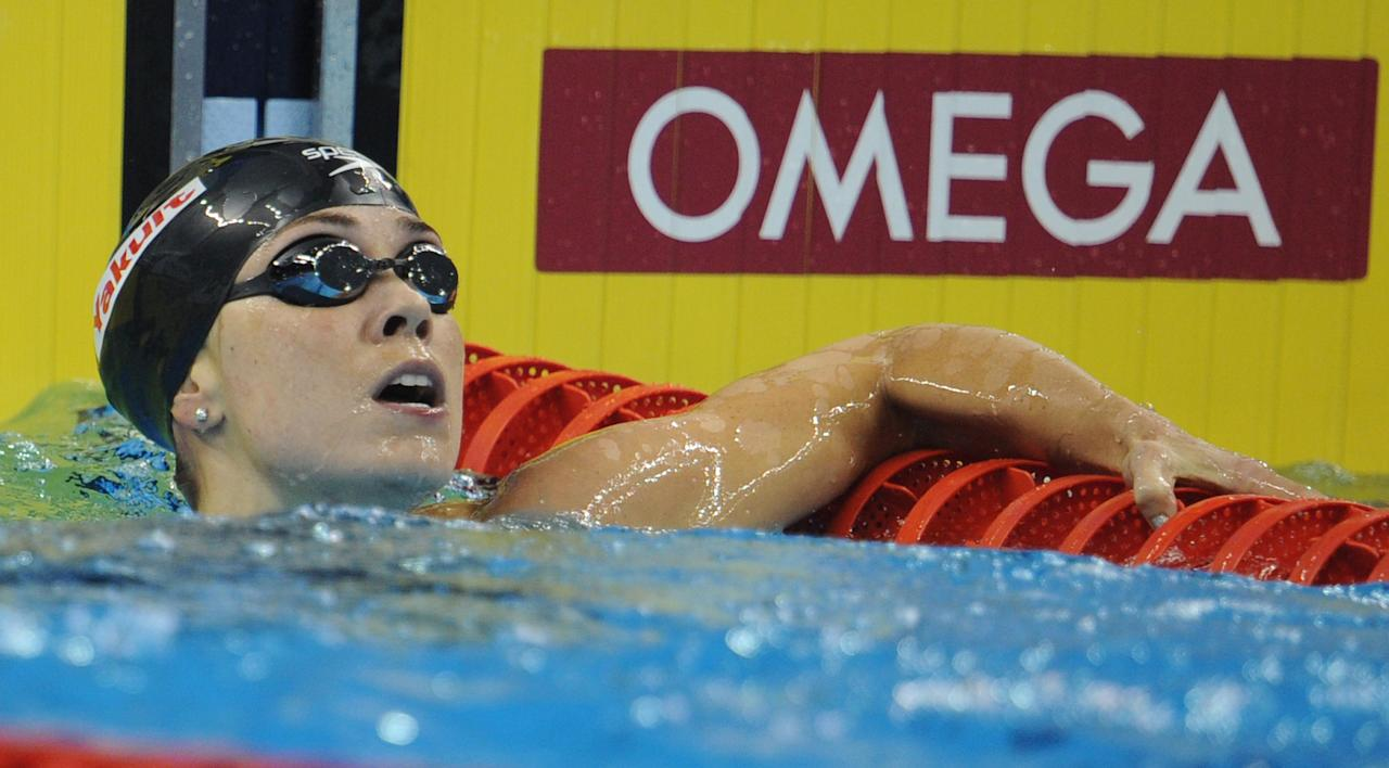 US swimmer Natalie Coughlin looks on after she competed in the final of the women's 100-metre backstroke swimming event in the FINA World Championships at the indoor stadium of the Oriental Sports Center in Shanghai on July 26, 2011. She won bronze.  AFP PHOTO / PETER PARKS (Photo credit should read PETER PARKS/AFP/Getty Images)