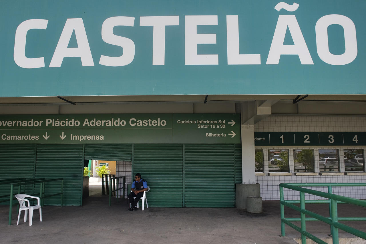 FORTALEZA, BRAZIL - SEPTEMBER 20: Security staff guard the entrance of the Governador Placido Aderaldo Castelo Stadium, known as Castelao Stadium, on September 20, 2010 in Fortaleza, Brazil. The Castelao will be Fortaleza's stadium on the 2014 FIFA World Cup. (Photo by Keiny Andrade/LatinContent/Getty Images)