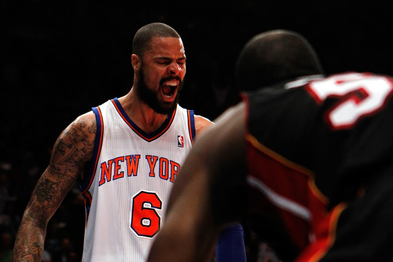 NEW YORK, NY - MAY 06:  Tyson Chandler #6 of the New York Knicks reacts against the Miami Heat in the second half of Game Four of the Eastern Conference Quarterfinals in the 2012 NBA Playoffs on May 6, 2012 at Madison Square Garden in New York City. NOTE TO USER: User expressly acknowledges and agrees that, by downloading and or using this photograph, User is consenting to the terms and conditions of the Getty Images License Agreement  (Photo by Jeff Zelevansky/Getty Images)