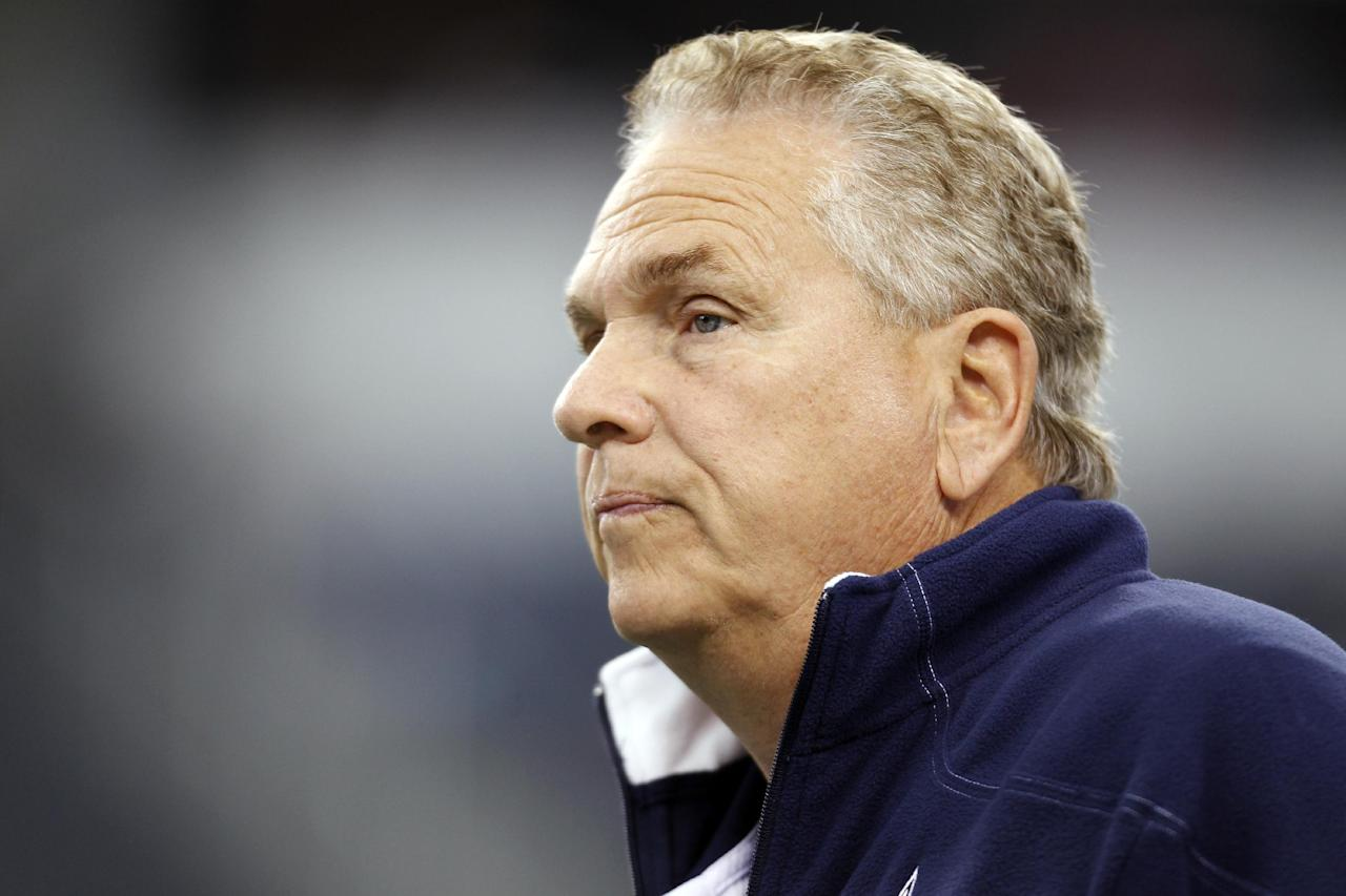 FILE - In this Nov. 24, 2011, file photo, Dallas Cowboys secondary coach Dave Campo watches before an NFL football game against the Miami Dolphins in Arlington, Texas. Veteran NFL and college coach Campo was hired as Kansas' new defensive coordinator on Friday, Jan. 13, 2012, less than a week after he left the Dallas Cowboys. Campo will also coach the defensive backs. (AP Photo/Sharon Ellman, File)