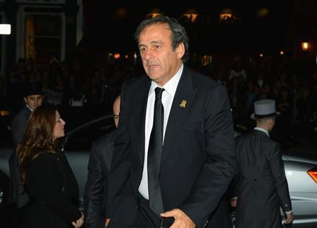 UEFA president Platini arrives to attend the FA150 Gala Dinner commemorating the Football Association's 150th year at the Grand Connaught Rooms in London