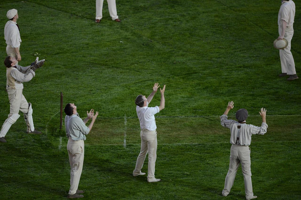 LONDON, ENGLAND - JULY 27:  Performers play cricket on the pitch during the preshow during the Opening Ceremony of the London 2012 Olympic Games at the Olympic Stadium on July 27, 2012 in London, England.  (Photo by Roger Sedres/Gallo Images/Getty Images)