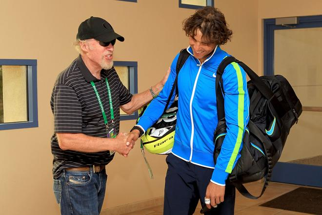 INDIAN WELLS, CA - MARCH 16: Phil Knight, founder and chairman of Nike, congratulates Rafael Nadal of Spain after his win over David Nalbandian of Argentina during the BNP Paribas Open at the Indian Wells Tennis Garden on March 16, 2012 in Indian Wells, California.  (Photo by Matthew Stockman/Getty Images)