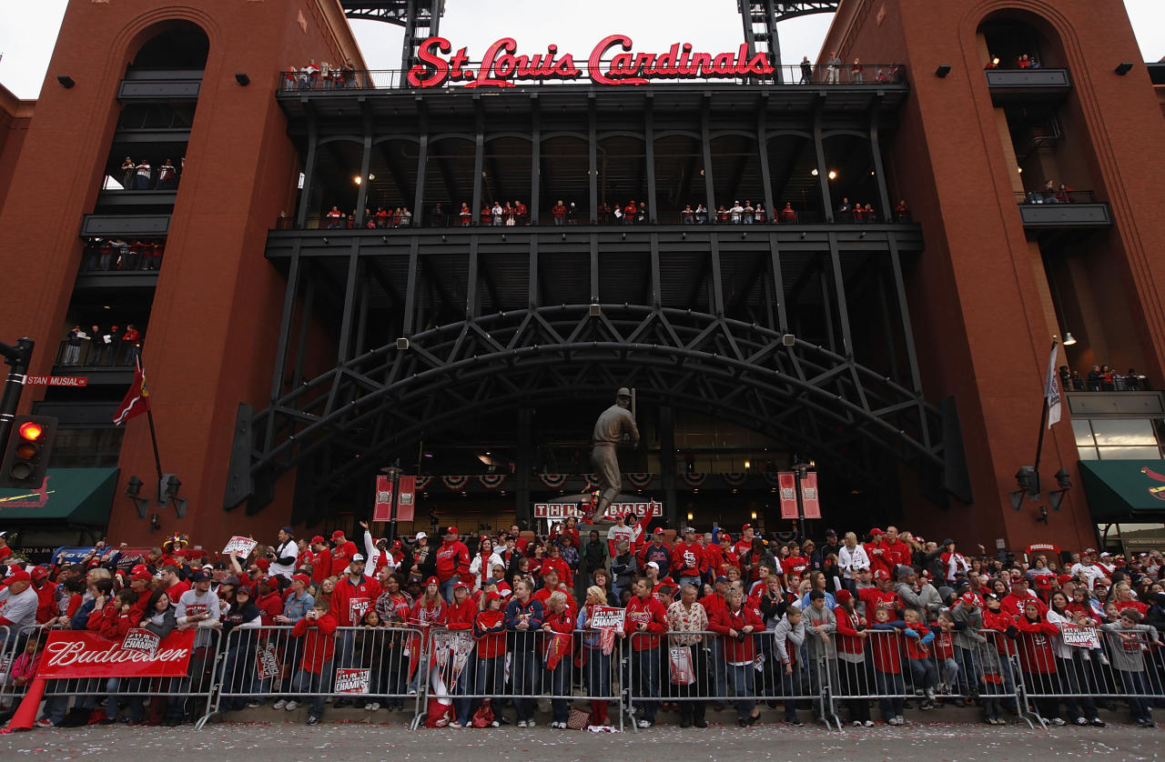 ST. LOUIS, MO - OCTOBER 30:  St. Louis Cardinals fans celebrate outside Busch Stadium during a parade celebrating the team's 11th World Series championship October 30, 2011 in St. Louis, Missouri. (Photo by Whitney Curtis/Getty Images)