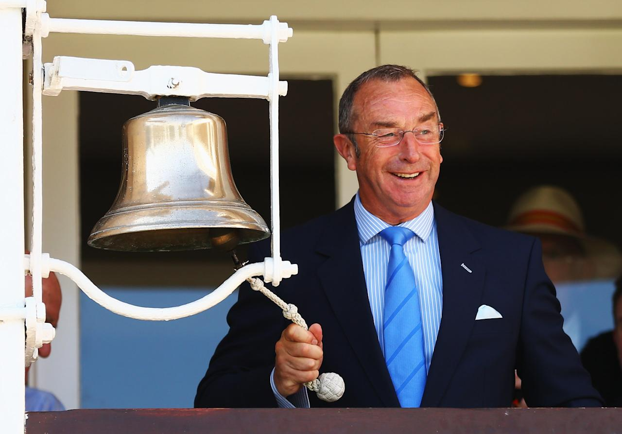 LONDON, ENGLAND - AUGUST 18:  David Lloyd rings the fifve minute bell prior to the start of day three of the third Investec test match between England and South Africa at Lord's Cricket Ground on August 18, 2012 in London, England.  (Photo by Paul Gilham/Getty Images)