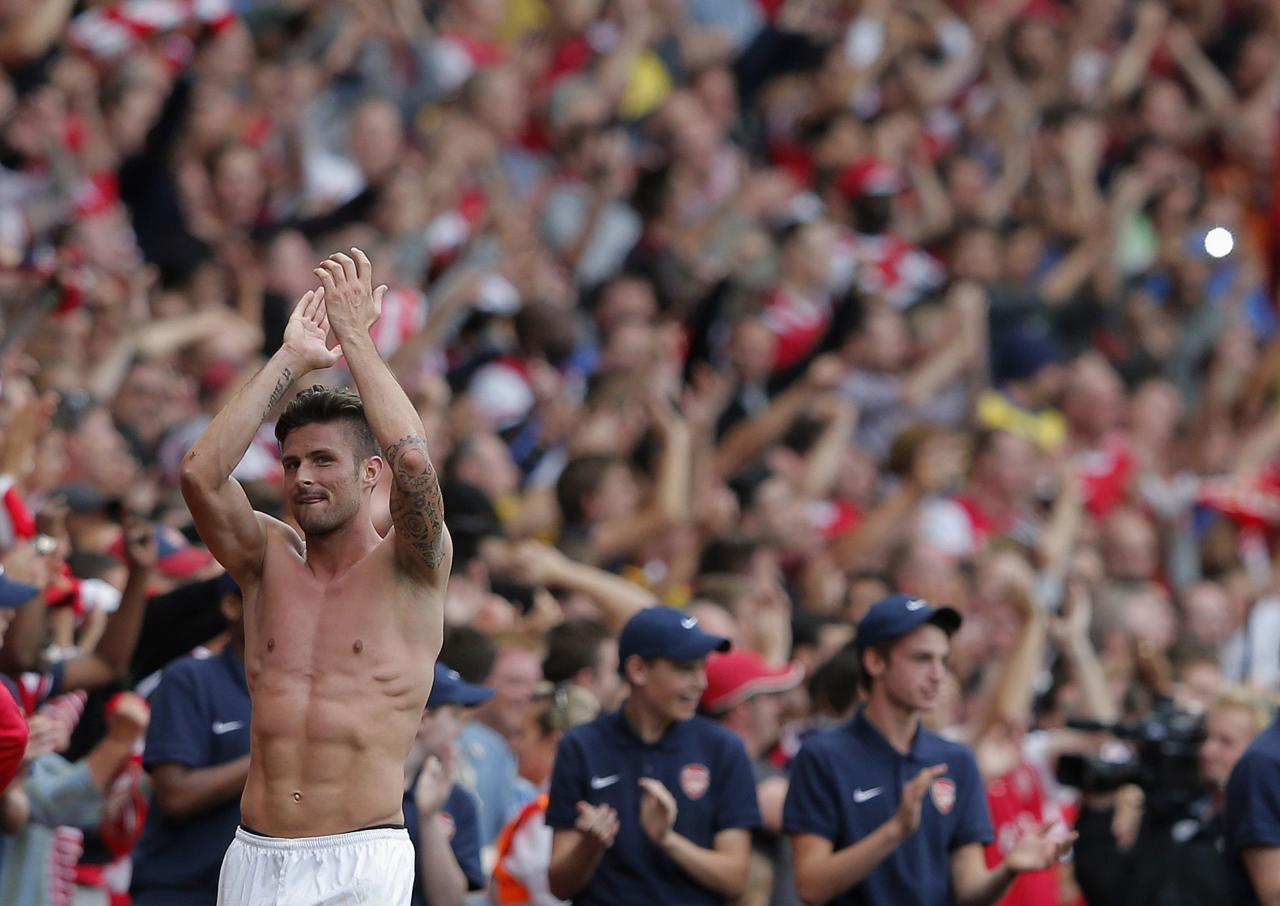 """Arsenal's Olivier Giroud reacts after their English Premier League soccer match against Tottenham Hotspur at the Emirates, London, England September 1, 2013. REUTERS/Eddie Keogh (BRITAIN - Tags: SPORT SOCCER) FOR EDITORIAL USE ONLY. NOT FOR SALE FOR MARKETING OR ADVERTISING CAMPAIGNS. NO USE WITH UNAUTHORIZED AUDIO, VIDEO, DATA, FIXTURE LISTS, CLUB/LEAGUE LOGOS OR """"LIVE"""" SERVICES. ONLINE IN-MATCH USE LIMITED TO 45 IMAGES, NO VIDEO EMULATION. NO USE IN BETTING, GAMES OR SINGLE CLUB/LEAGUE/PLAYER PUBLICATIONS"""