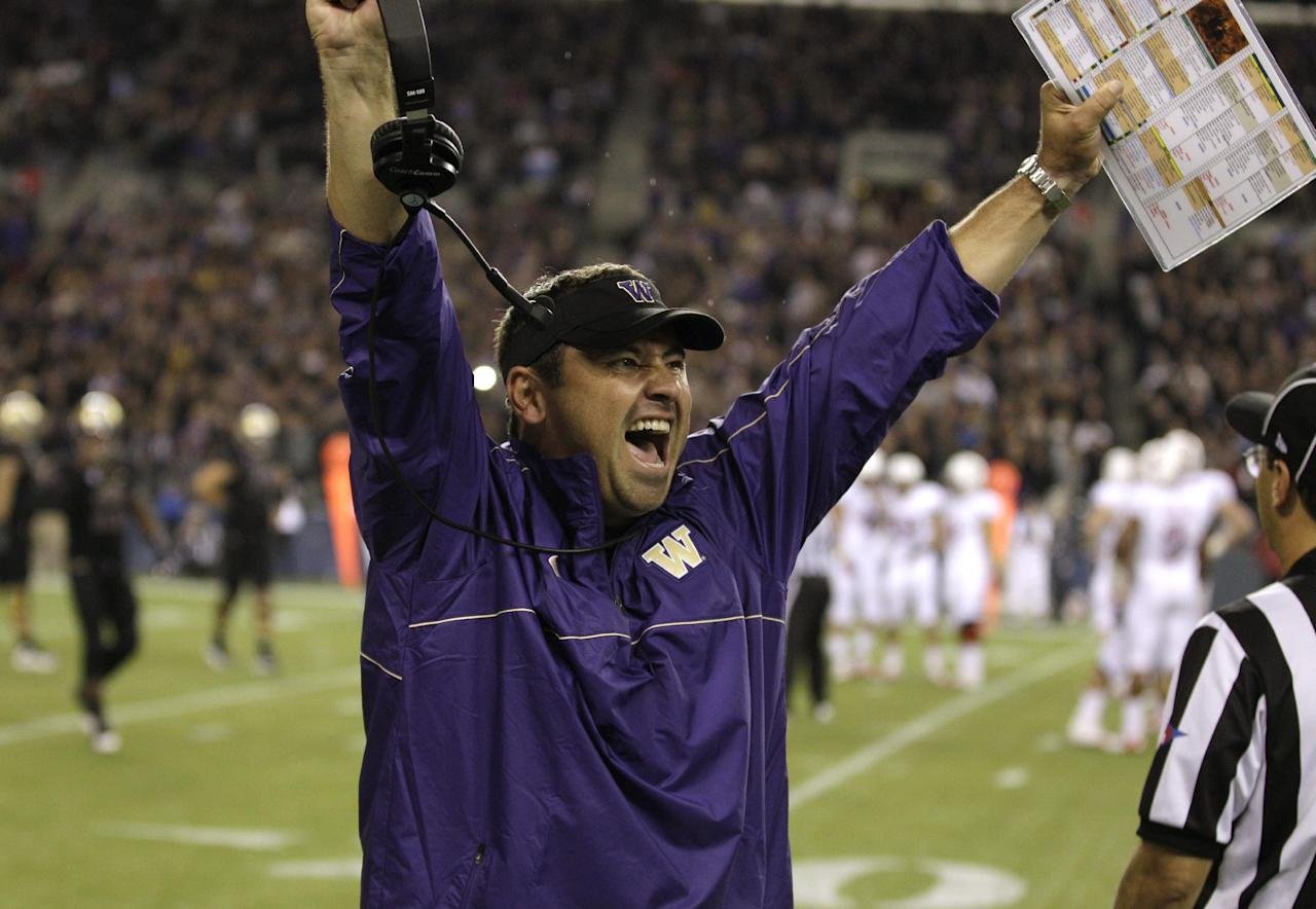 Washington head coach Steve Sarkisian celebrates a play late in an NCAA college football game against Stanford, Thursday, Sept. 27, 2012, in Seattle. Washington beat Stanford, 17-13. (AP Photo/Ted S. Warren)
