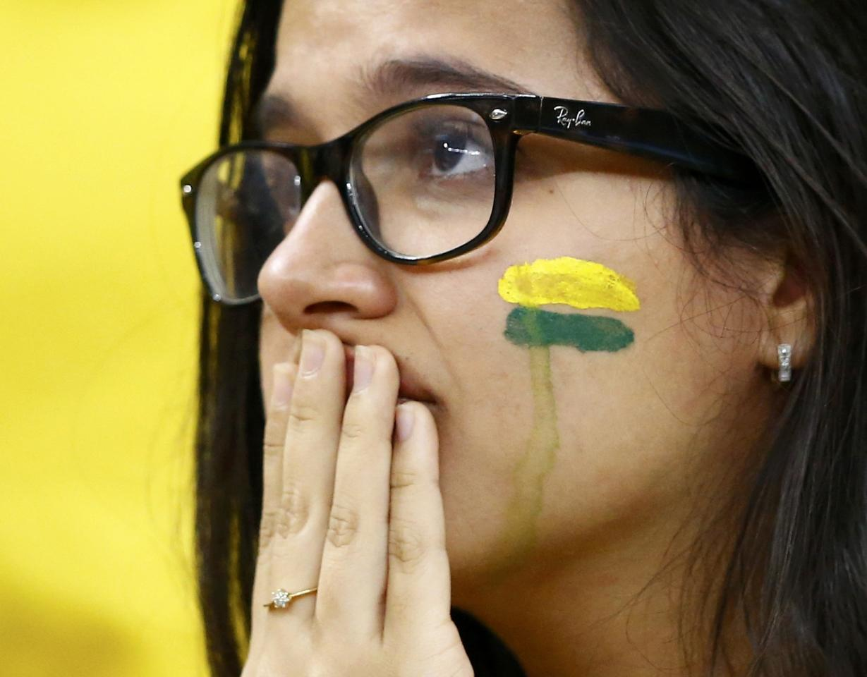 A Brazil fan reacts after they lost their 2014 World Cup third-place playoff against the Netherlands at the Brasilia national stadium in Brasilia July 12, 2014. REUTERS/Dominic Ebenbichler (BRAZIL - Tags: SOCCER SPORT WORLD CUP)