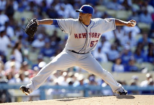 New York Mets starting pitcher Johan Santana (57) pitches against the Los Angeles Dodgers during the first inning of their baseball game in Los Angeles, Saturday, June 30, 2012. (AP Photo/Alex Gallardo)