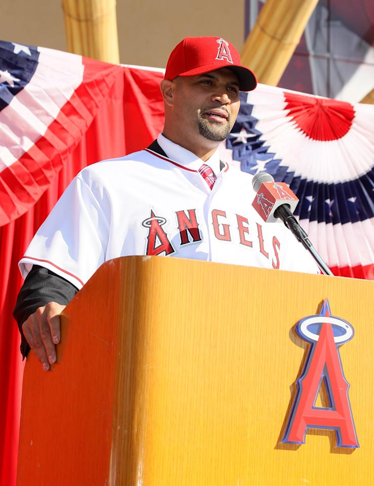 ANAHEIM, CA - DECEMBER 10:  Albert Pujols speaks at a public press conference introducing newly signed Los Angeles Angels of Anaheim  players Pujols and C.J. Wilson at Angel Stadium on December 10, 2011 in Anaheim, California.  (Photo by Stephen Dunn/Getty Images)