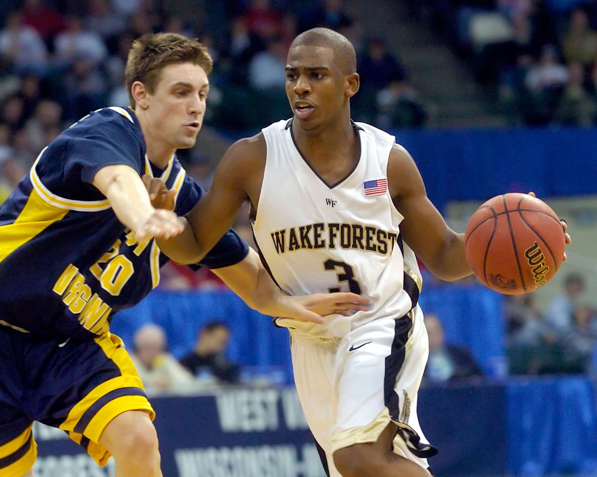 Wake Forest's Chris Paul (3) drives on West Virginia's Mike Gansey (20) during the second half in the second round of the NCAA tournament Saturday, March 19, 2005, in Cleveland. (AP Photo/Jeff Glidden)
