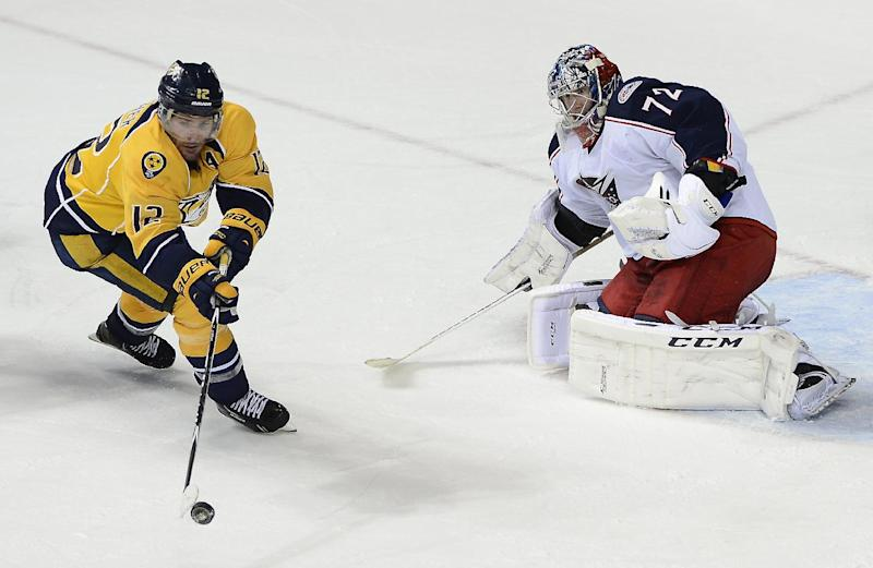 Nashville Predators forward Mike Fisher (12) tries to get a shot off at Columbus Blue Jackets goalie Sergei Bobrovsky (72), of Russia, in the third period of an NHL hockey game on Saturday, March 8, 2014, in Nashville, Tenn. The Blue Jackets won 1-0