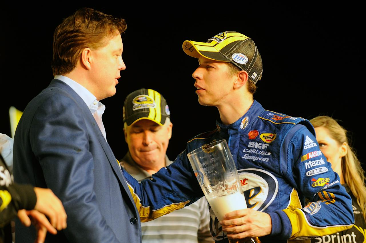 HOMESTEAD, FL - NOVEMBER 18:  Brad Keselowski, driver of the #2 Miller Lite Dodge, talks with NASCAR chairman and CEO Brian France in Champions Victory Lane after winning the series championship and finishing in fifteenth place for the NASCAR Sprint Cup Series Ford EcoBoost 400 at Homestead-Miami Speedway on November 18, 2012 in Homestead, Florida.  (Photo by Jared C. Tilton/Getty Images for NASCAR)