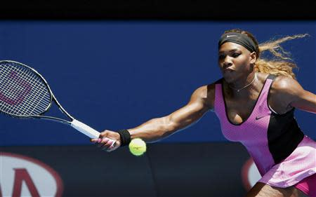 Serena Williams of the U.S. hits a return to Vesna Dolonc of Serbia during their women's singles match at the Australian Open 2014 tennis tournament in Melbourne