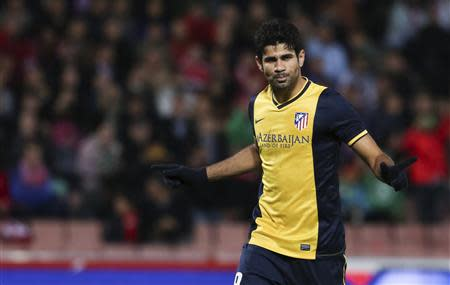 Atletico Madrid's Diego Costa celebrates after scoring against Granada during their soccer match in Granada