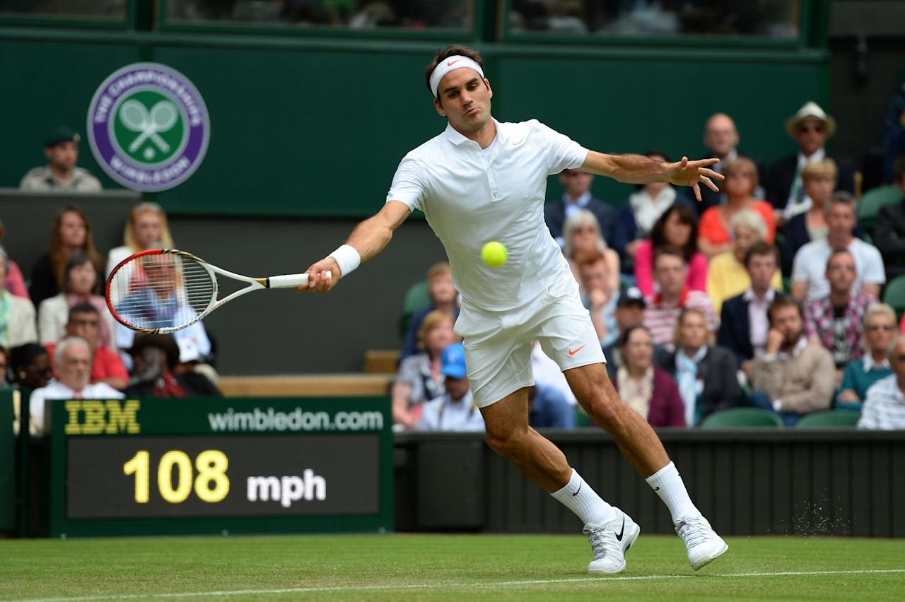 LONDON, ENGLAND - JUNE 26: Roger Federer of Switzerland plays a forehand during his Gentlemen's Singles second round match against Sergiy Stakhovsky of Ukraine on day three of the Wimbledon Lawn Tennis Championships at the All England Lawn Tennis and Croquet Club on June 26, 2013 in London, England. (Photo by Mike Hewitt/Getty Images)