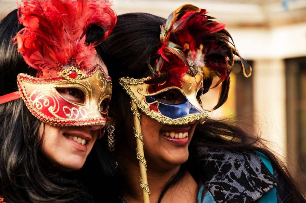 Tourists enjoy the Carnival in Venice. Venice can be very touristy and restaurants with signboards such as 'Menu Turistico' are to be avoided.
