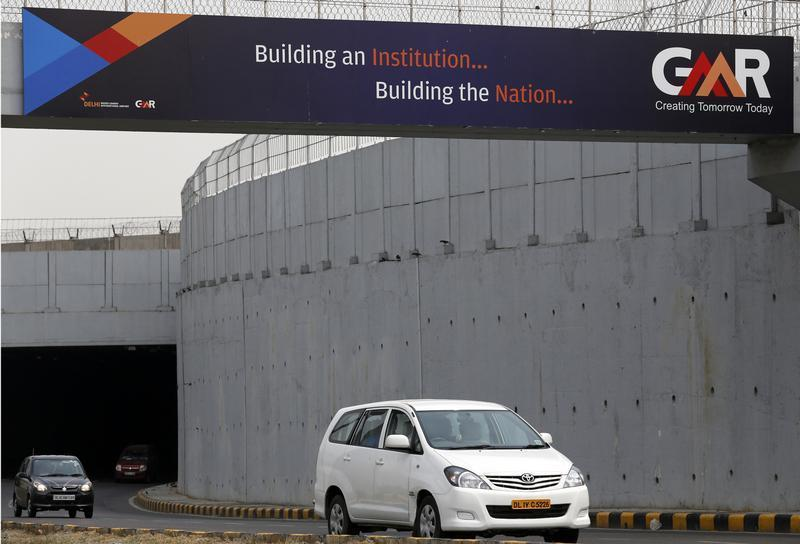 Vehicles cross through an underpass constructed by GMR Infrastructure that connects to the airport in New Delhi