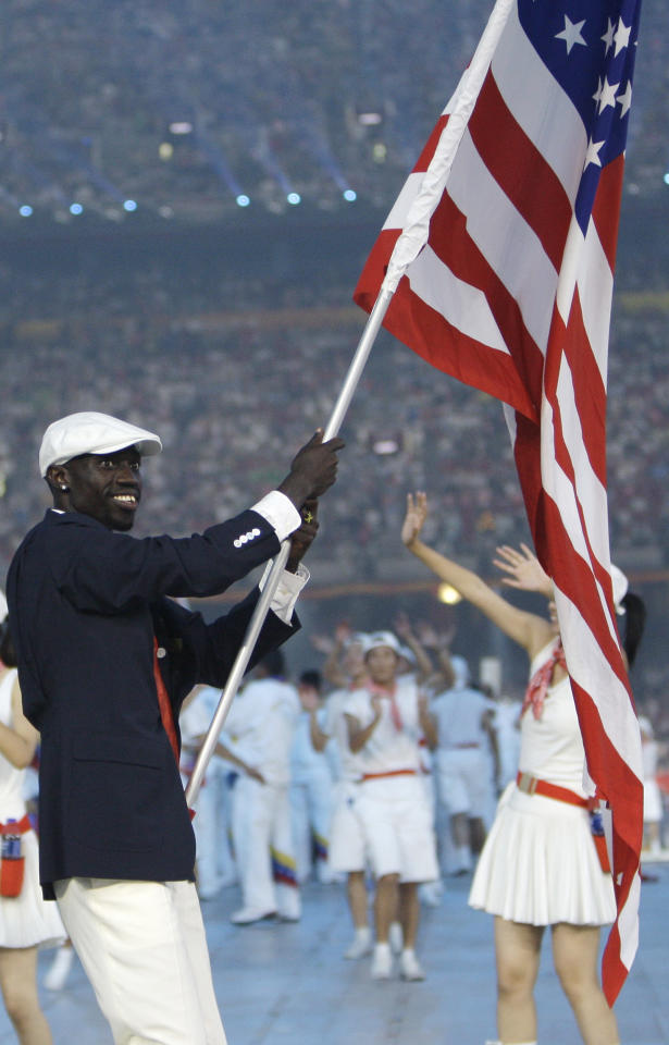 Lopez Lomong carries the flag of United States during the opening ceremonies for the Beijing 2008 Olympics in Beijing, Friday, Aug. 8, 2008. (AP Photo/Kevin Frayer)