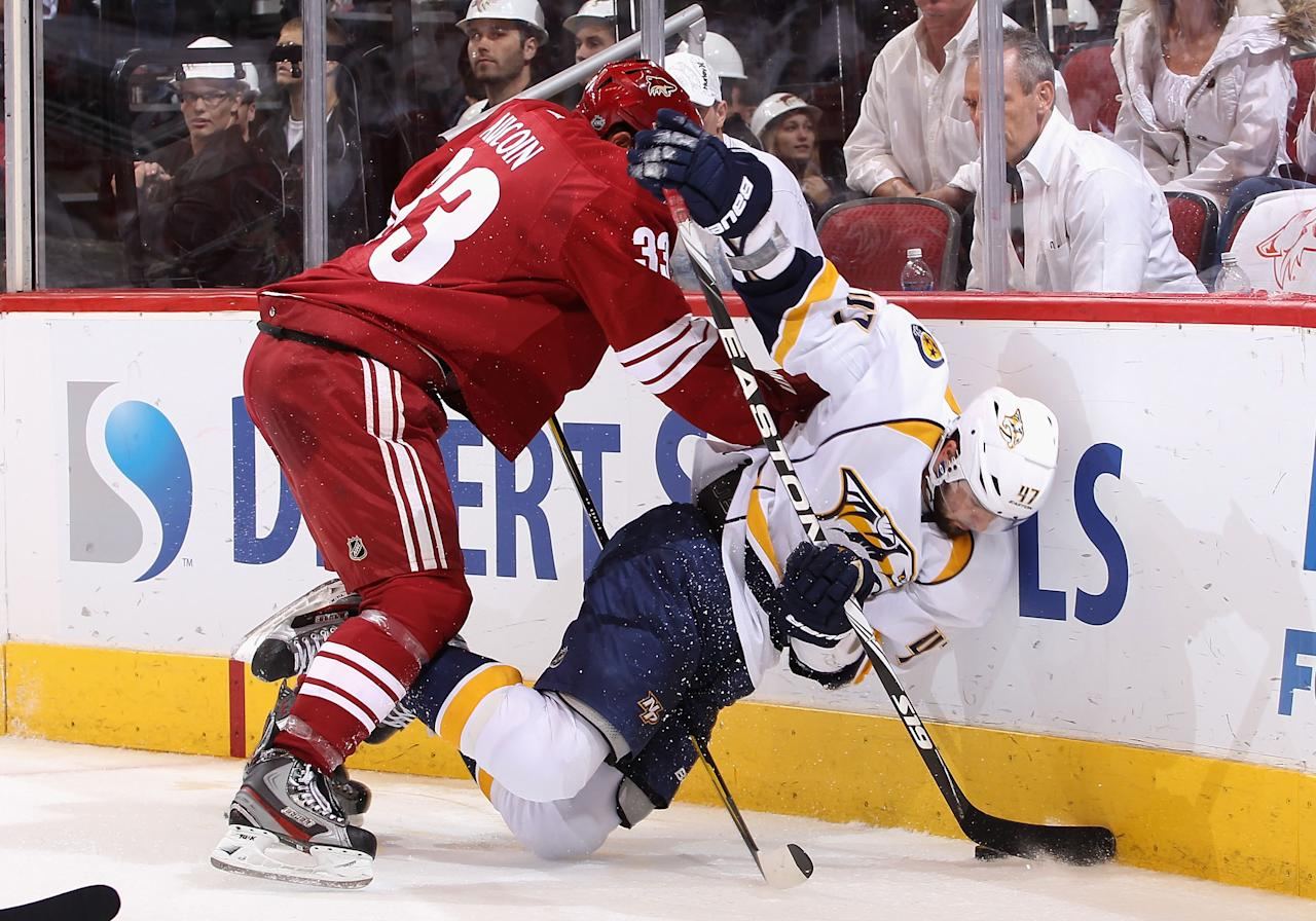 GLENDALE, AZ - MAY 07:  Alexander Radulov #47 of the Nashville Predators is knocked down by Adrian Aucoin #33 of the Phoenix Coyotes as he attempts to control the puck in Game Five of the Western Conference Semifinals during the 2012 NHL Stanley Cup Playoffs at Jobing.com Arena on May 7, 2012 in Glendale, Arizona.  (Photo by Christian Petersen/Getty Images)