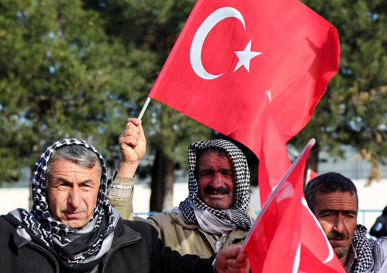 People wave Turkish flags during a protest against Saturday's blast targetting military personnel in Kayseri, in the southeastern city of Diyarbakir, Turkey, December 18, 2016. REUTERS/Sertac Kayar