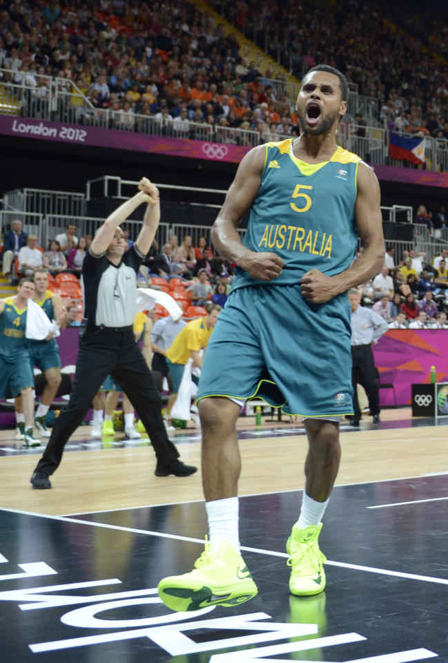 Jul 29, 2012; London, United Kingdom; Australia guard Patrick Mills (5) reacts during the men's basketball preliminary against Brazil during the 2012 London Olympic Games at the Basketball Arena. Mandatory Credit: Bob Donnan-USA TODAY Sports